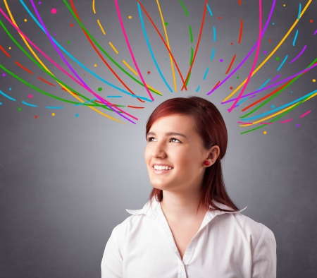 Pretty young girl thinking with colorful abstract lines overhead Stock Photo - 18072886