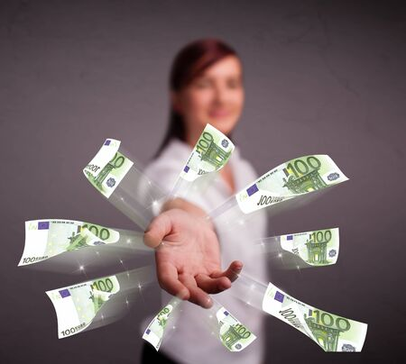 Pretty young woman standing and throwing money Stock Photo - 18072899