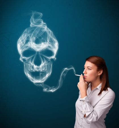 fire skull: Pretty young woman smoking dangerous cigarette with toxic skull smoke