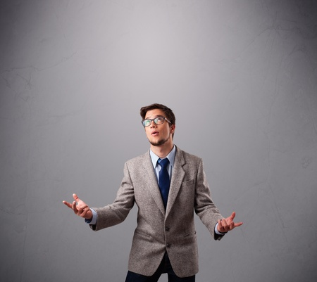 juggler: funny man standing and juggling with copy space Stock Photo