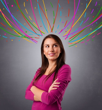 Pretty young girl thinking with colorful abstract lines overhead Stock Photo - 18489496