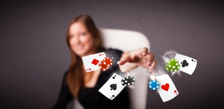 Pretty young woman playing with poker cards and chips  photo