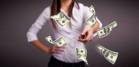 Beautiful young girl throwing money Stock Photo - 18489730