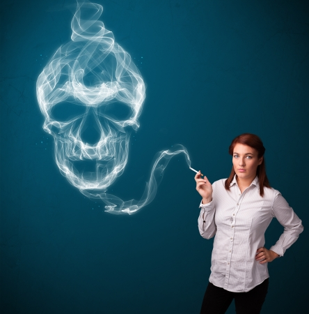 Pretty young woman smoking dangerous cigarette with toxic skull smoke  Stock Photo - 18488987
