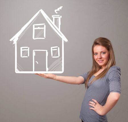 Beautiful young lady holding a huge drawn house Stock Photo - 18489820