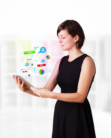 woman tablet: Young business woman looking at modern tablet with colourful technology icons