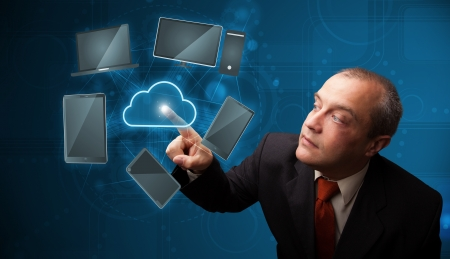 Businessman standing and touching high technology cloud service Stock Photo - 18489374