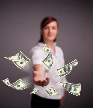 Beautiful young girl throwing money Stock Photo - 18529879