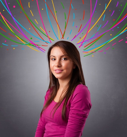 Pretty young girl thinking with colorful abstract lines overhead photo