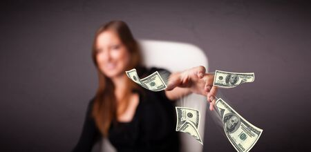Beautiful young girl throwing money Stock Photo - 18761408