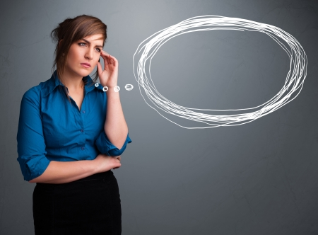 theorize: Beautiful young lady thinking about speech or thought bubble with copy space Stock Photo