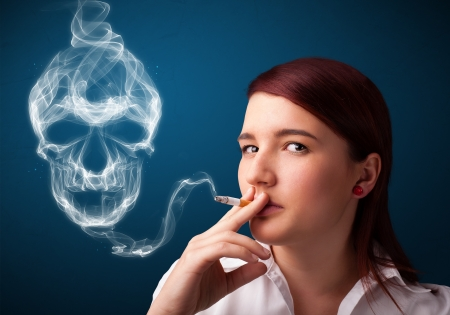 Pretty young woman smoking dangerous cigarette with toxic skull smoke Stock Photo - 18761332