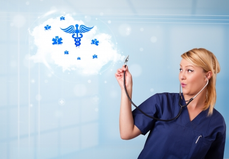 Beautiful young doctor with abstract cloud and medical icons Stock Photo - 18761442