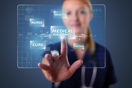 medical choice: Young nurse standing and pressing modern medical type of buttons Stock Photo