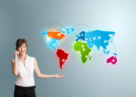 telecommunications: Beautiful young woman making phone call with colorful world map Stock Photo