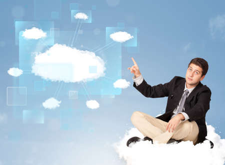 Happy young man looking at modern cloud network photo