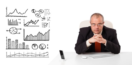 Businessman sitting at desk with diagrams and graphs, isolated on white Stock Photo - 18761395