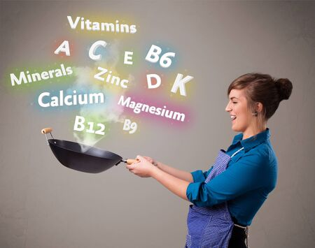 Pretty young woman cooking vitamins and minerals Stock Photo - 18919440
