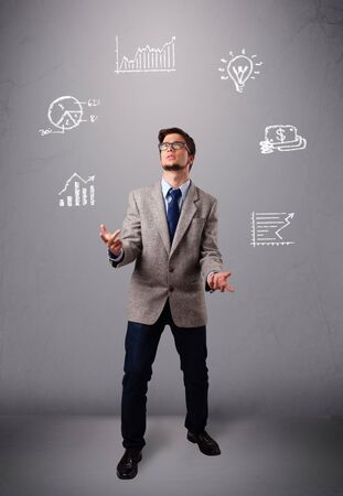juggle: young boy standing and juggling with statistics and graphs Stock Photo