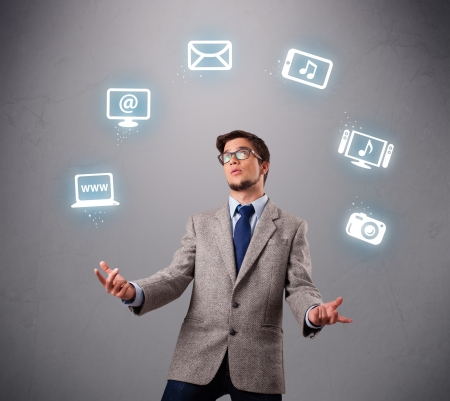 funny boy standing and juggling with electronic devices icons
