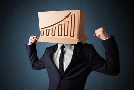 Businessman standing and gesturing with a cardboard box on his head with diagram photo