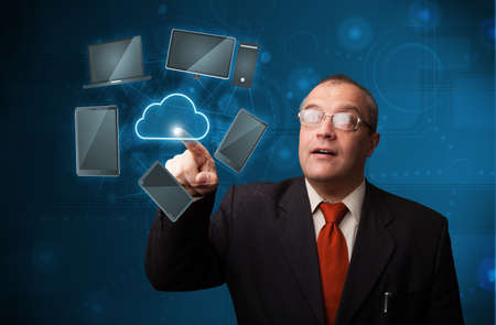 Businessman standing and touching high technology cloud service Stock Photo - 18919520