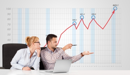 to interpret: Young businessman and businesswoman calculating stock market with rising graph in the background