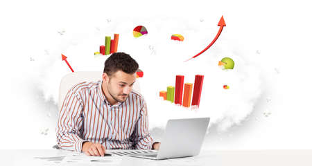 Handsome young businessman with cloud in the background containing colorful graphs and diagrams Stock Photo
