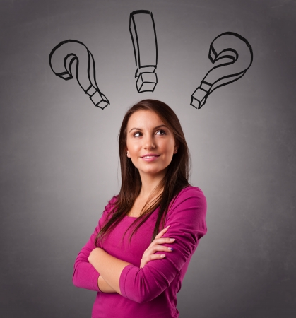 Beautiful young lady thinking with question marks overhead photo