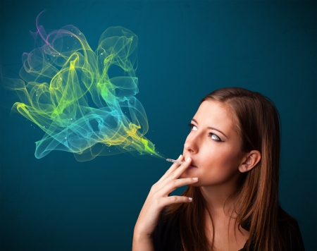 cigare: Pretty young lady smoking cigarette with colorful smoke Stock Photo
