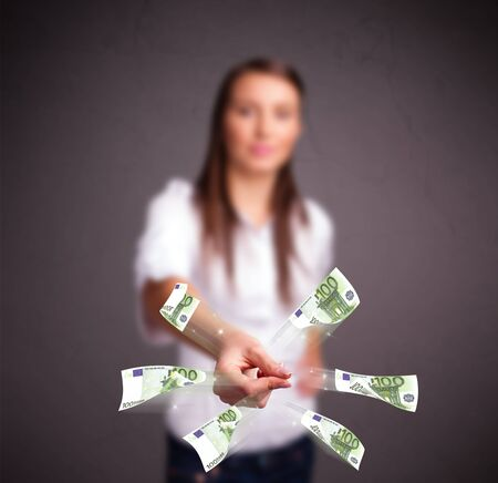 Pretty young woman standing and throwing money Stock Photo - 18969557