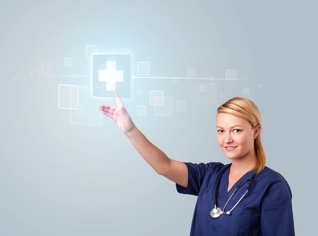 Pretty young nurse pressing modern medical type of buttons photo