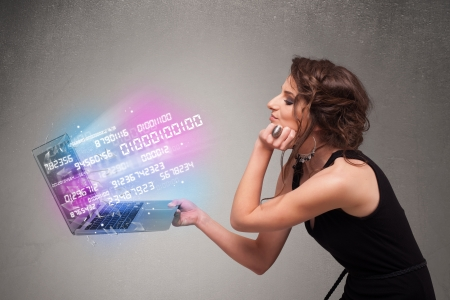cyber woman: Attractive casual woman holding laptop with exploding data and numers