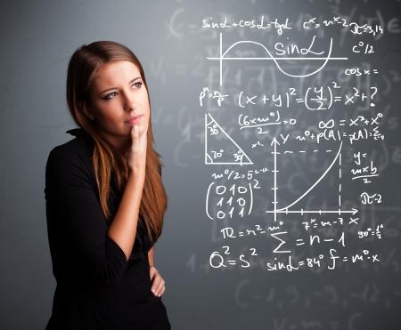 signos matematicos: Joven y bella muchacha de la escuela pensando en signos matem�ticos complejos