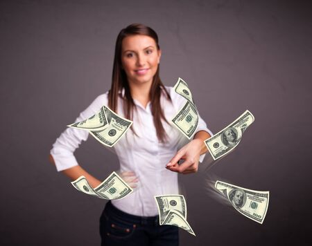 Beautiful young girl throwing money Stock Photo - 19124371