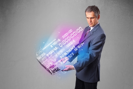 encode: Attractive businessman holding notebook with exploding data and numbers Stock Photo