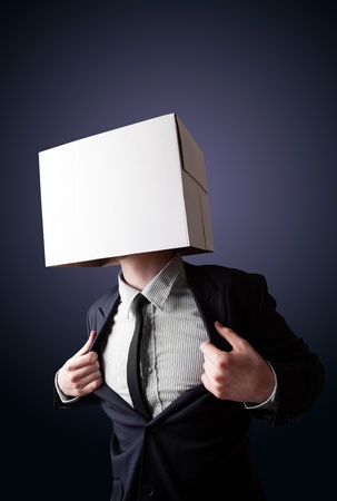 boxy: Businessman standing and gesturing with a cardboard box on his head Stock Photo
