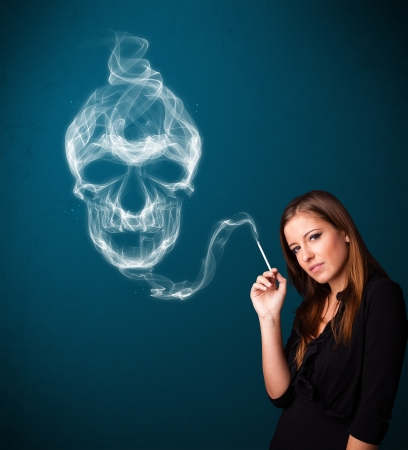 Pretty young woman smoking dangerous cigarette with toxic skull smoke Stock Photo - 19292769