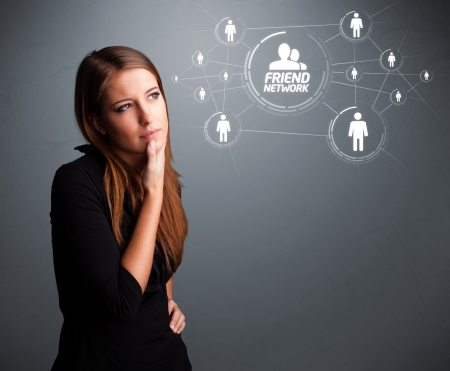 medium group of people: Attractive young girl looking at modern social network Stock Photo