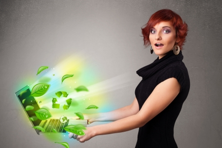Casual young woman holding notebook with recycle and environmental symbols Stock Photo - 19294281