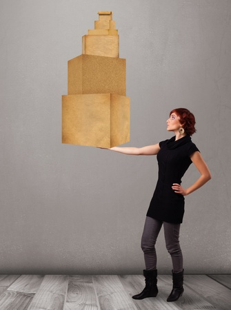 Attractive young lady holding a set of brown cardboard boxes Stock Photo - 19339002