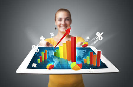 Beautiful young woman holding tablet with colorful graphs and diagrams photo