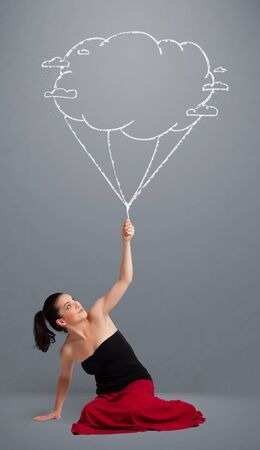 Pretty young lady holding a cloud balloon drawing Stock Photo - 19294292