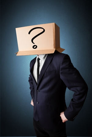 masquerader: Businessman standing and gesturing with a cardboard box on his head with question mark