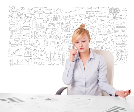 Pretty young businesswoman planning and calculating various business ideas photo