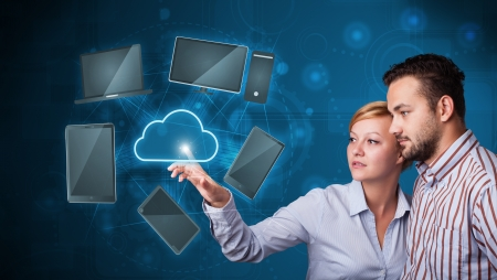 wireles: Happy young couple touching cloud service