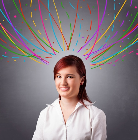 Pretty young girl thinking with colorful abstract lines overhead Stock Photo - 19374381
