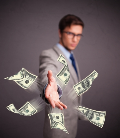 Handsome young man throwing money Stock Photo