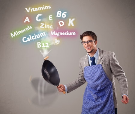 shef: Handsome man cooking vitamins and minerals