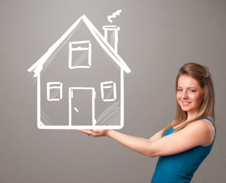 Beautiful young lady holding a huge drawn house Stock Photo - 19374374